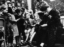 Maria Montessori, Italian educator, with a large group of children from